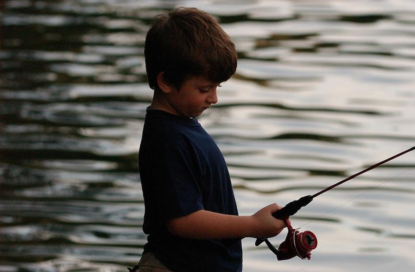 """I'll land one soon."" - Young fisherman at Apple Tree Bay, Bobbin Head, Sydney."