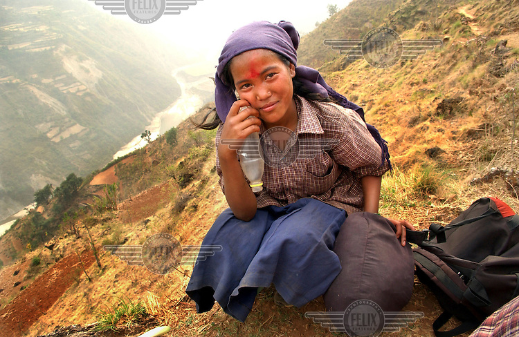 A schoolgirl forced to take part in a cultural education programme run by the Maoists in Rukum district. The Maoist rebels continually abduct villagers to take part in military training, work details and political indoctrination.