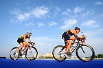 PUERTO VALLARTA, MEXICO - OCTOBER 23:  Sarah Haskins of the USA bikes in front of Pamelia Nascimento of Brazil during the Triathlon competition on Day Eight of the XVI Pan American Games on October 23, 2011 in Puerto Vallarta, Mexico.  (Photo by Donald Miralle for Mexsport) *** Local Caption ***