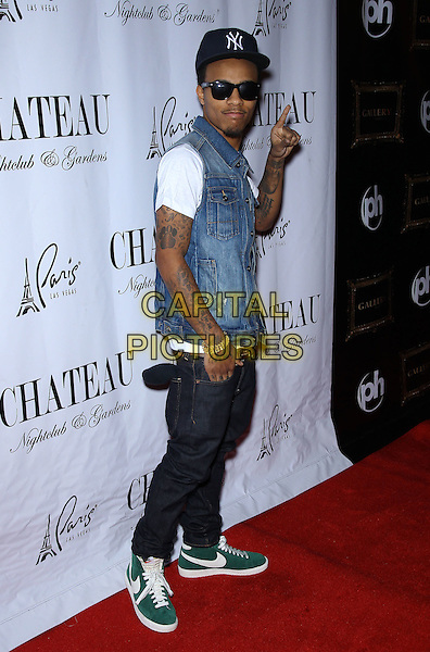 Bow Wow aka Shad Gregory Moss.Bow Wow walks the red carpet at Chateau Nightclub inside The Paris Las Vegas,  Las Vegas, Nevada, USA, .14th January 2012..full length cap hat sunglasses denim sleeveless  shirt white t-shirt jeans trainers  nike green  hand gesture .CAP/ADM/MJT.© MJT/AdMedia/Capital Pictures.