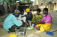 Family eating while listening to educational programme on rural radio