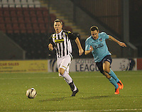 Declan Hughes gets away from Stephen Husband in the St Mirren v Dunfermline Athletic Scottish Professional Football League Under 20 match played at the Excelsior Stadium, Airdrie on 11.12.13.