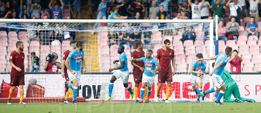 Calcio, Serie A: Napoli vs Roma. Napoli, stadio San Paolo, 15 ottobre. <br /> Napoli's Kalidou Koulibaly, fourth from left, celebrates after scoring during the Italian Serie A football match between Napoli and Roma at Naples' San Paolo stadium, 15 October 2016. Roma won 3-1.<br /> UPDATE IMAGES PRESS/Isabella Bonotto