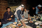 Marsh Arabs. Southern Iraq. Circa 1985. Banquet taking place in traditional village reed constructed building called a Mudhif. Only male members of community attended. Haur al Mamar or Haur al-Hamar marsh collectively known now as Hammar marshes Irag 1984