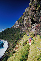 Mount Gower guided hike: tourists hiking along vertical cliffs of Mt. Lidgbird, Lord Howe Island, NSW, Australia