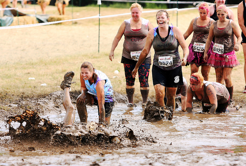 Racers compete in the 5K Dirty Girl Race in Milwaukee, Wisconsin on 8/19/2012.