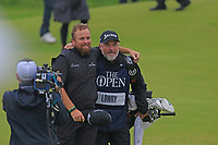 Shane Lowry (IRL) and caddy Bo walk down the 18th hole during Sunday's Final Round of the 148th Open Championship, Royal Portrush Golf Club, Portrush, County Antrim, Northern Ireland. 21/07/2019.<br /> Picture Eoin Clarke / Golffile.ie<br /> <br /> All photo usage must carry mandatory copyright credit (© Golffile | Eoin Clarke)