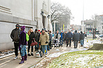 WATERBURY, CT. 21 December 2019-122119BS286 - A large group of people wait in the cold to enter a Christmas Party for the less fortunate and homeless at the Basilica of Immaculate Conception in Waterbury on Saturday. Bill Shettle Republican-American