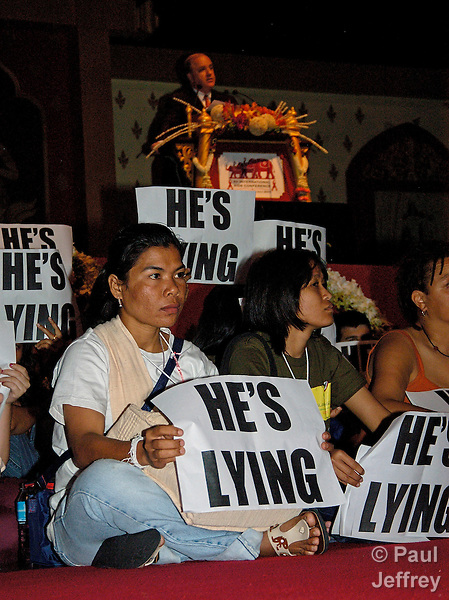 Demonstrators protest during a speech by U.S. AIDS Ambassador Randall Tobias to the XV International AIDS Conference in Bangkok. Demonstrators were protesting the U.S. government's opposition to the widespread use of lower cost generic drugs in poor countries and the resistance of the Bush administration to education about condoms in U.S.-funded prevention programs.