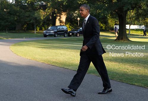 United States President Barack Obama returns to the White House on August 29, 2012..Credit: Dennis Brack / Pool via CNP