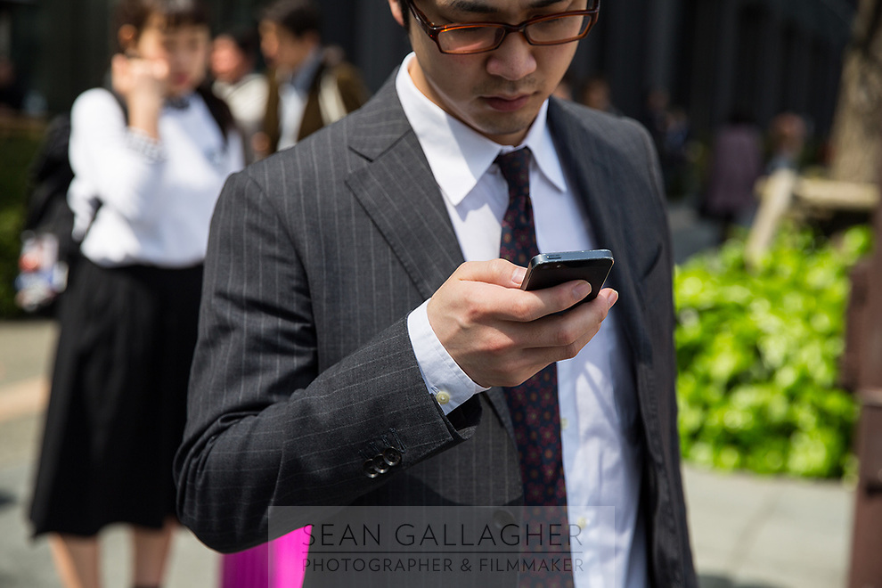 A businessman uses his phone in Tokyo.