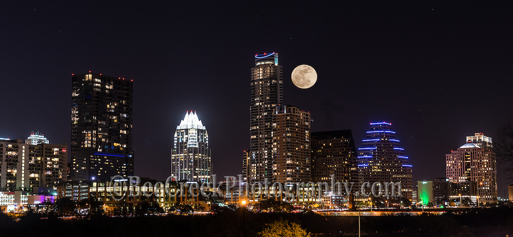 One evening in the fall we took this photo of a Austin skyline with a moonrise coming up over the city.  This was a special night when the wolf moon came up right over downtown Austin.  We captured the moon as it slowly rose to level of the Austonian high-rise with the Frost building off to it left.