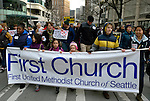 "Members of First United Methodist Church of Seattle carry a banner as they joined hundreds of other Seattle residents who marched from Westlake Center Park to the Seattle Center on January 13, 2013, calling for stricter regulations of firearms. Sponsored by a network of churches and other groups called ""Stand-up Washington,"" the demonstrators called for a state ban on semi-automatic weapons as well as stricter gun laws."