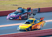 Oct 20, 2019; Ennis, TX, USA; NHRA funny car driver J.R. Todd (near) defeats Cruz Pedregon who suffered an engine explosion and fire during the Fall Nationals at the Texas Motorplex. Mandatory Credit: Mark J. Rebilas-USA TODAY Sports