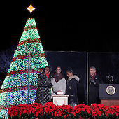 United States President Barack Obama and the First Family, Michelle Obama(left) Malia Obama(2nd left), Sasha Obama(2nd right) participate in the lighting of the National Christmas Tree on the Ellipse in Washington, D.C. on Thursday, December 4, 2014. <br /> Credit: Chris Kleponis / Pool via CNP