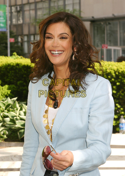 TERI HATCHER.2005/2006 ABC UpFront - Show, Lincoln Center in New York City.May 17, 2005.half length blue suit jacket laughing smiling.www.capitalpictures.com.sales@capitalpictures.com.©Capital Pictures