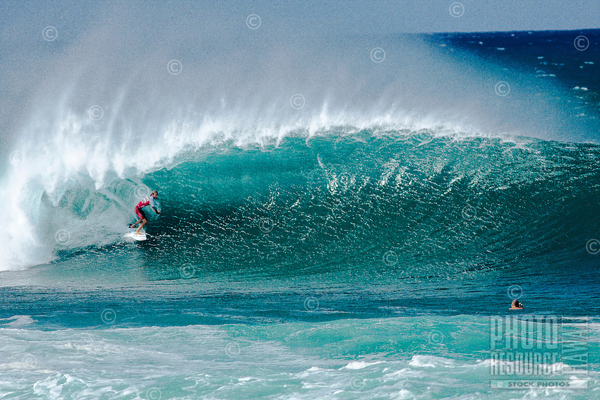 b7b7e3603bfbd5 Surfer getting barrelled on a big wave at the 2011 Billabong Pro Pipe  Masters surfing contest