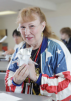 New York, NY, USA - June 26, 2011: Beverly Baudino, Origami folder from California, at the OrigamiUSA Convention in New York City holding a mouse designed by Mike Assis which she folded.