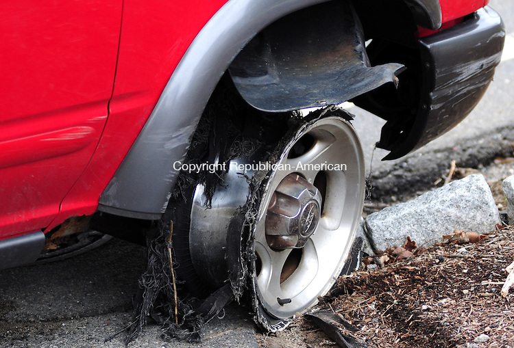 PLYMOUTH, CT, 11 APR 13- 041113AJ01- A Thomaston man was charged with drunken driving at 3 p.m. Thursday after crashing his Explorer on South Street and then running away from the vehicle.  Alec Johnson/ Republican-American