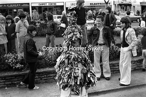Minehead Dunster Hobby Horse Guisers.  Somerset UK 1970s. Boy dressed as Guisers on the last evening. Guiser  with collecting Tin. My ref 19/959/1975,