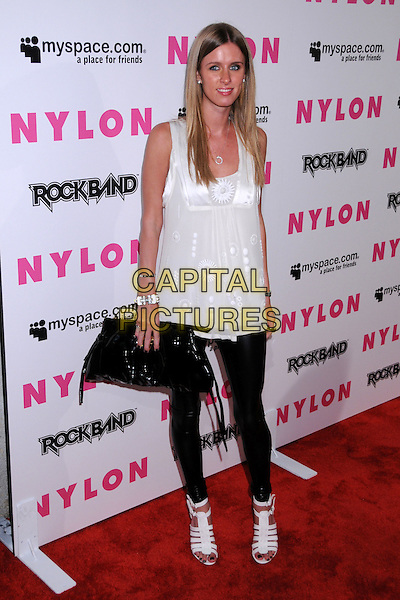 NICKY HILTON.Nylon Magazine and MySpace Celebrate their 3rd Annual Music Issue, Hollywood, California, USA..June 3rd, 2008.full length black leggings white sleeveless top sheer clutch bag purse straps strappy shoes sandals .CAP/ADM/BP.©Byron Purvis/AdMedia/Capital Pictures.