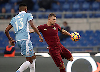 Calcio, Serie A: Lazio vs Roma. Roma, stadio Olimpico, 4 dicembre 2016.<br /> Roma&rsquo;s Edin Dzeko, right, kicks the ball past Lazio's Wallace during the Italian Serie A football match between Lazio and Rome at Rome's Olympic stadium, 4 December 2016. Roma won 2-0.<br /> UPDATE IMAGES PRESS/Isabella Bonotto