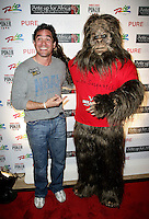 DEAN CAIN & Sasquatch .The Ante Up for Africa Celebrity Poker Tournament at the Rio Resort Hotel and Casino, Las Vegas, Nevada, USA..July 2nd, 2009.full length costume dress-up jeans denim grey gray.CAP/ADM/MJT.© MJT/AdMedia/Capital Pictures