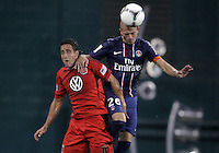 WASHINGTON, DC - July 28, 2012:  Josh Wolff (16) of DC United is beaten to a header by Christophe Jallet (26) of PSG (Paris Saint-Germain) in an international friendly match at RFK Stadium in Washington DC on July 28. The game ended in a 1-1 tie.