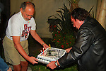 "JERRY RUBIN & GUEST. The host carries the birthday cake at the George Harrison Public Birthday Celebration by the Alliance for Survival, hosted by Jerry Rubin and ""Breakfast with the Beatles"" radio host Chris Carter at George Harrison's star on the Walk of Fame. Hollywood, CA, USA. February 25, 2010."