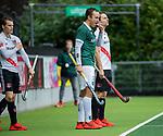 AMSTELVEEN -   Marnix Kleinsman (R'dam)  en  Tom Hiebendaal (Adam) komen inzet veld tijdens de hoofdklasse competitiewedstrijd heren, AMSTERDAM-ROTTERDAM (2-2). COPYRIGHT KOEN SUYK