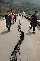 Refugees flee their mountain homes for the lowland city of Chengdu as landslides and aftershocks continue following the 12th May earthquake..15 May 2008