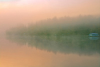 Fog at sunrise at Peniac Bay. West Hawk Lake<br />