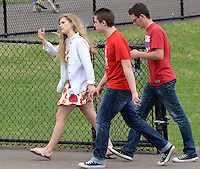SOUDERTON, PA - APRIL 14:  Students exit the football field after a bomb threat forced the evacuation of Souderton High School April 14, 2014 in Souderton, Pennsylvania. (Photo by William Thomas Cain/Cain Images)