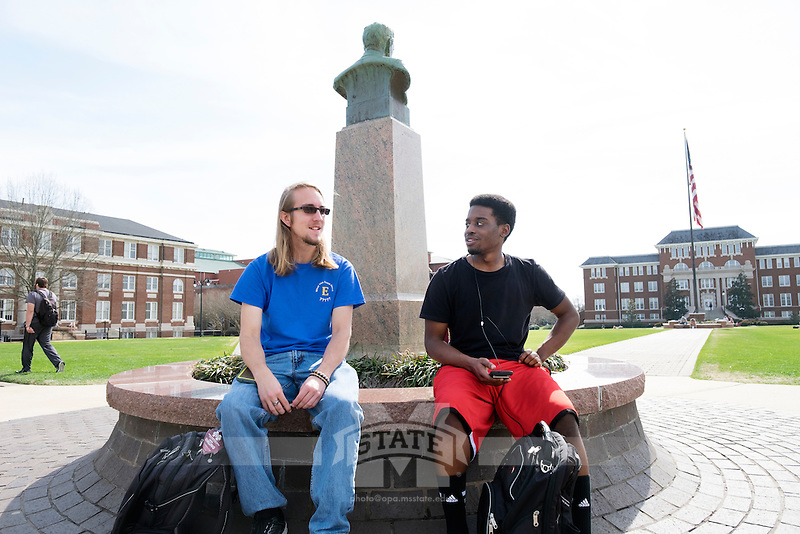 Drill Field Spring Day. Friends hanging out at the Stephen D. Lee statue: Zack Schilling (blue), Darian Randolph.<br />  (photo by Megan Bean / &copy; Mississippi State University)