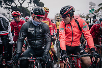 teammates for years André Greipel (DEU/Lotto-Soudal) & Jurgen Roelandts (BEL/BMC) cathing up at the race start in torrential rained down Nice<br /> <br /> 76th Paris-Nice 2018<br /> Stage 8: Nice > Nice (110km)