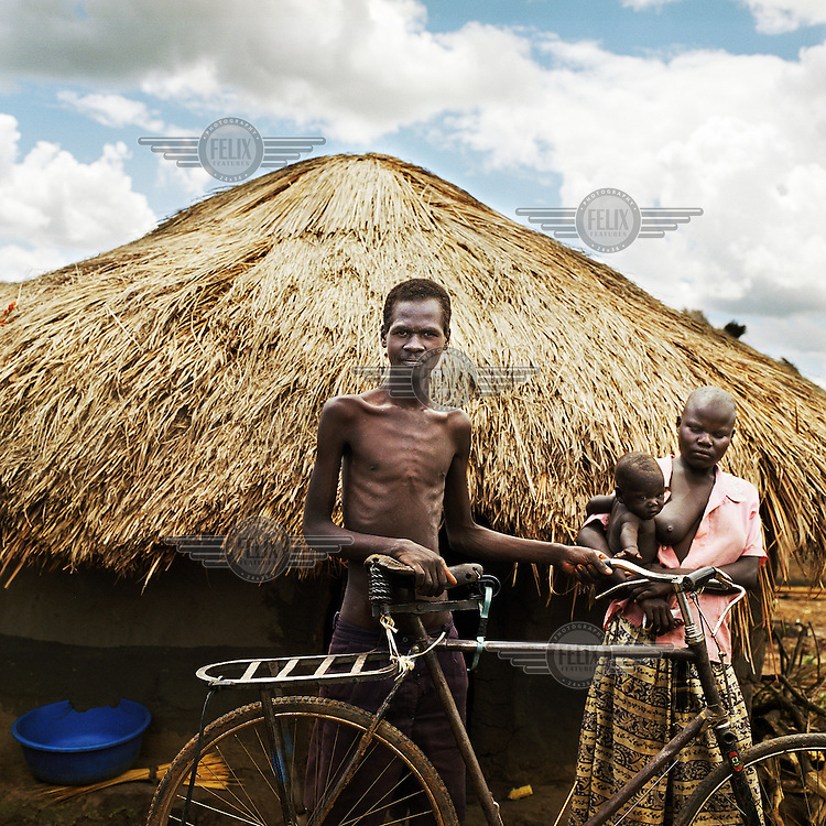 """David Otim suffers from malaria and tuberculosis (TB). He became ill after he was abducted by the Lord's Resistance Army (LRA). He later managed to escape and fled to Agweng camp with his family and a bicycle. The bike is the only thing he has left from his old life. He used to be a farmer. Now he depends on the goodwill of his neighbours in the camp for internally displaced people (IDPs) because he is not yet eligible for distributed food handouts.  .For 18 years the LRA rebels have terrorised the Northern provinces of Uganda abducting 20,000 children and forcing 1.6 million people to flee their homes. According to Medecins Sans Frontieres (MSF) the mortality rate among children in some areas is five times the rate internationally agreed to constitute an 'emergency out of control'. The UN's under-secretary general for humanitarian affairs has called Northern Uganda the """"largest neglected humanitarian emergency in the world""""."""