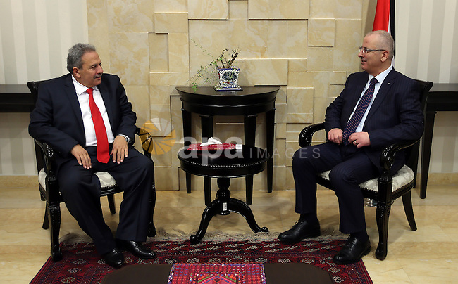 Palestinian Prime Minister, Rami Hamdallah, meet with, Constitutional Court Chairman Alhaji Mohammed Qasim, in the West Bank city of Ramallah, on April 7, 2016. Photo by Prime Minister Office