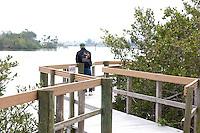 Man on dock looking down The Gulf Intercoastal Waterway.  Indian Rocks Beach Tampa Bay Area Florida USA