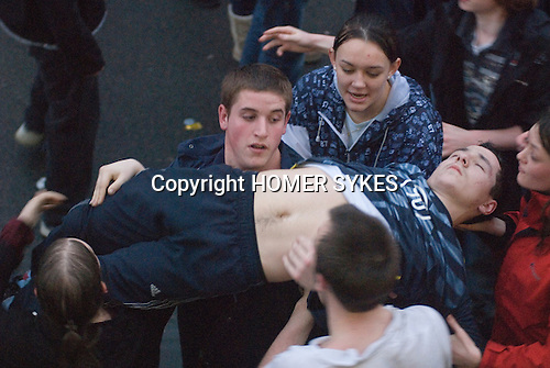 Shrove Tuesday Football. Atherstone Warwickshire UK 2008. A young man is dragged out of the scrummage unconscious. .