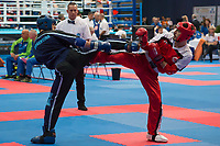 Yuksel Faruk Mert (in red) of Turkey and Gianni Lucio (in blue) of Argentina fight in the men's -69 kg preliminary during the WAKO World Kick-boxing Championships in Budapest, Hungary on Nov. 6, 2017. ATTILA VOLGYI