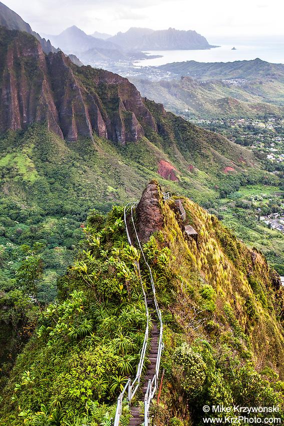 "An aerial view of the Ko'olau mountain range & Haiku valley at dawn from Haiku Stairs (""Stairway to Heaven"") hiking trail in Kaneohe, Oahu"