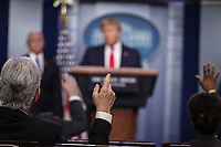 Members of the media rise their hands to ask questions to United States President Donald J. Trump during a press conference with members of the coronavirus task force in the Brady Press Briefing Room of the White House on March 24, 2020 in Washington, DC.<br /> Credit: Oliver Contreras / Pool via CNP/AdMedia