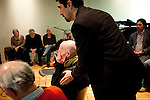 Vietnam Veteran Patrick Dillan (C) is comforted by Scott Thompson (C-R), Director of Social Dialogue and Training Initiatives at Intersections International, after participating in a role playing session during the Veteran-Civilian Dialogue at Intersections International on February 4, 2011 in New York City.  (PHOTOGRAPH BY MICHAEL NAGLE)