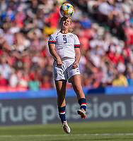 PARIS,  - JUNE 16: Lindsey Horan #9 heads the ball during a game between Chile and USWNT at Parc des Princes on June 16, 2019 in Paris, France.