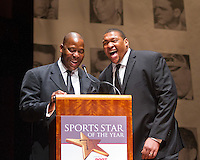 Former Seahawk Jacob Green and current Seahawks defensive lineman Red Bryant joke before presenting Eastern Washington University football team, winners of the FCS National Championship, with the 2011 Sports Story of the Year Award at the 77th Annual Sports Star of the Year, presented by ROOT SPORTS, at Benaroya Hall in Seattle Wednesday, Jan. 25, 2012. The evening honors Northwest sports stars, carrying on an annual tradition started by Seattle Post-Intelligencer sports editor Royal Brougham in 1936. (Photography by Dan DeLong/Red Box Pictures)