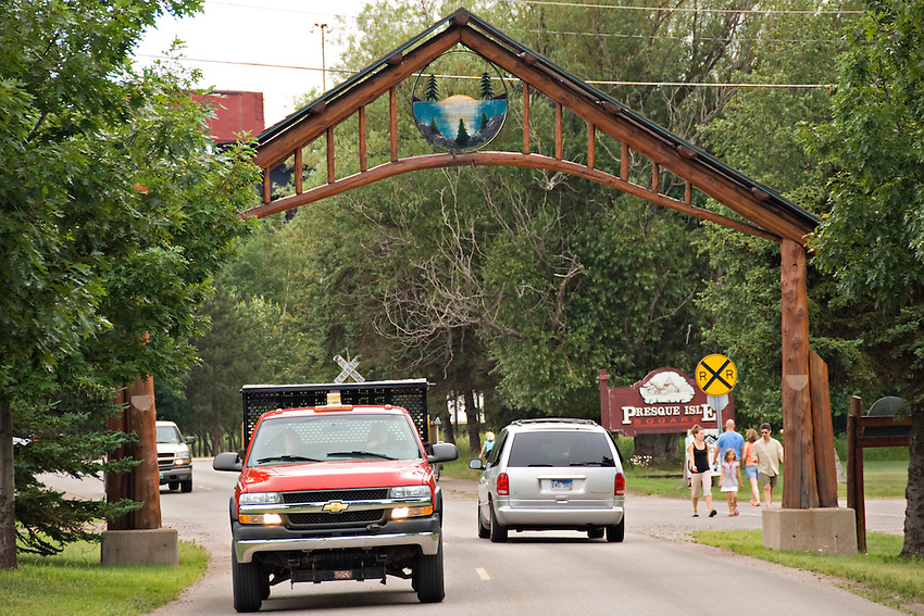 Pedestrian and vehicle traffic at the entrance to Presque Isle Park in Marquette Michigan.