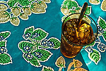 Still life glass of iced tea on colorful tablecloth