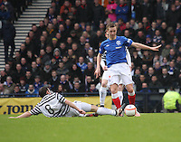 David Anderson slides in to tackle Robbie Crawford in the Queen's Park v Rangers Irn-Bru Scottish League Division Three match played at Hampden Park, Glasgow on 29.12.12.