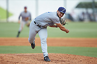 Pensacola Blue Wahoos relief pitcher Hector Lujan (35) follows through on his delivery against the Birmingham Barons at Regions Field on July 7, 2019 in Birmingham, Alabama. The Barons defeated the Blue Wahoos 6-5 in 10 innings. (Brian Westerholt/Four Seam Images)