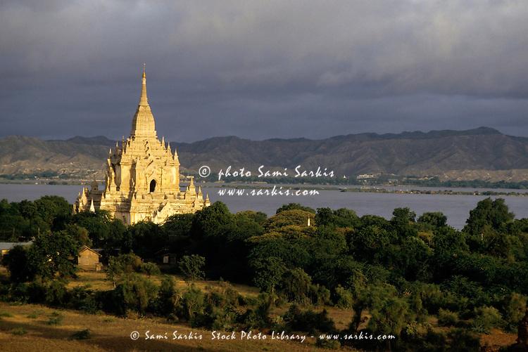Gawdawpalin Temple and historic pagodas at sunrise along the Irrawady River, Bagan, Burma.